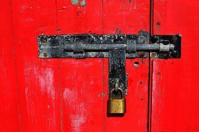 Red locked door ©Owen J Fitzpatrick