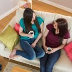 two girls on sofa shutterstock_154725254
